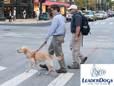 blind man with dog crossing street image